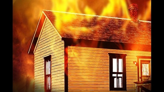 Woman declared dead after house fire